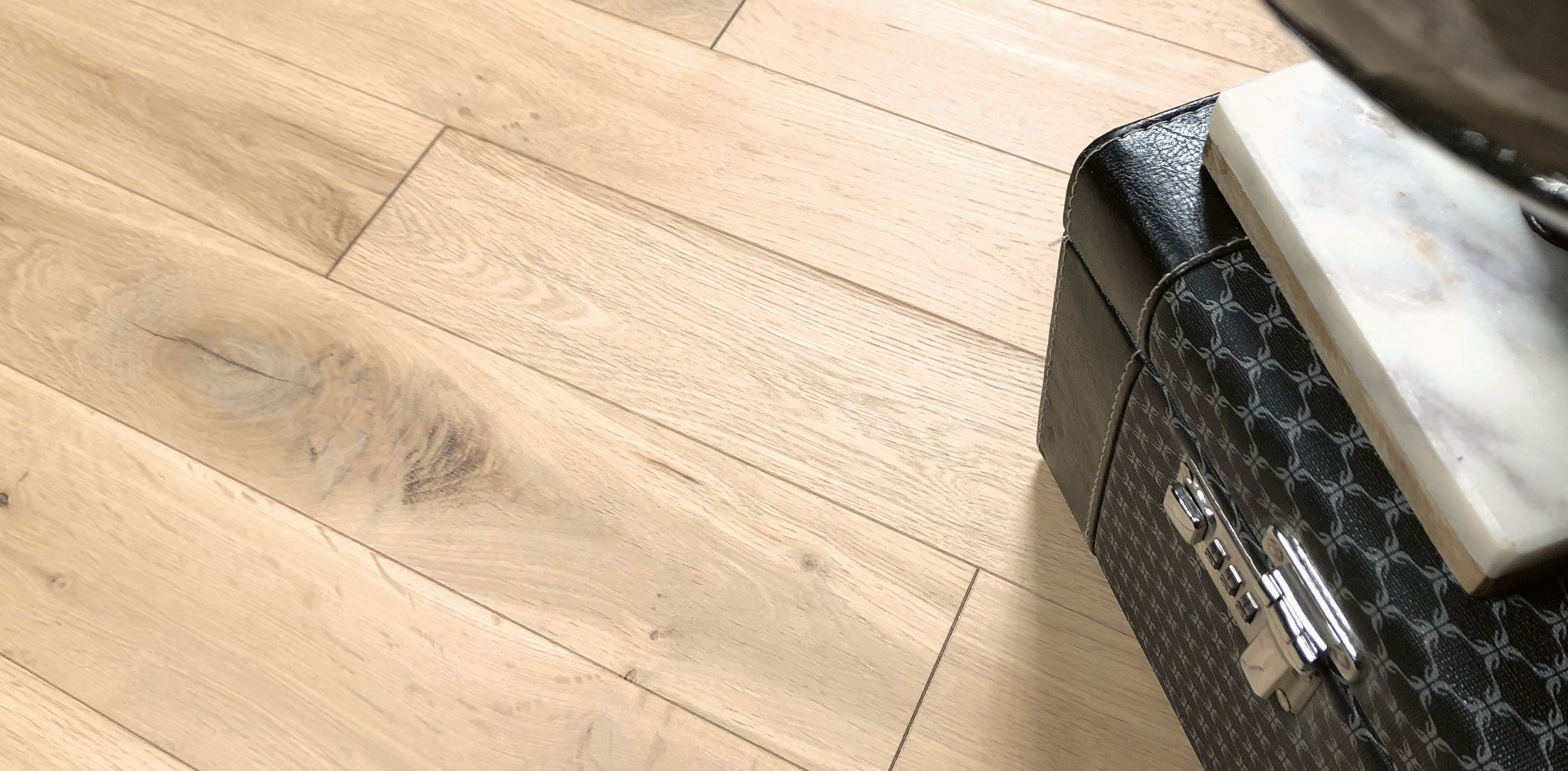 dune-hardwood-flooring-with-suitcase-and-globe
