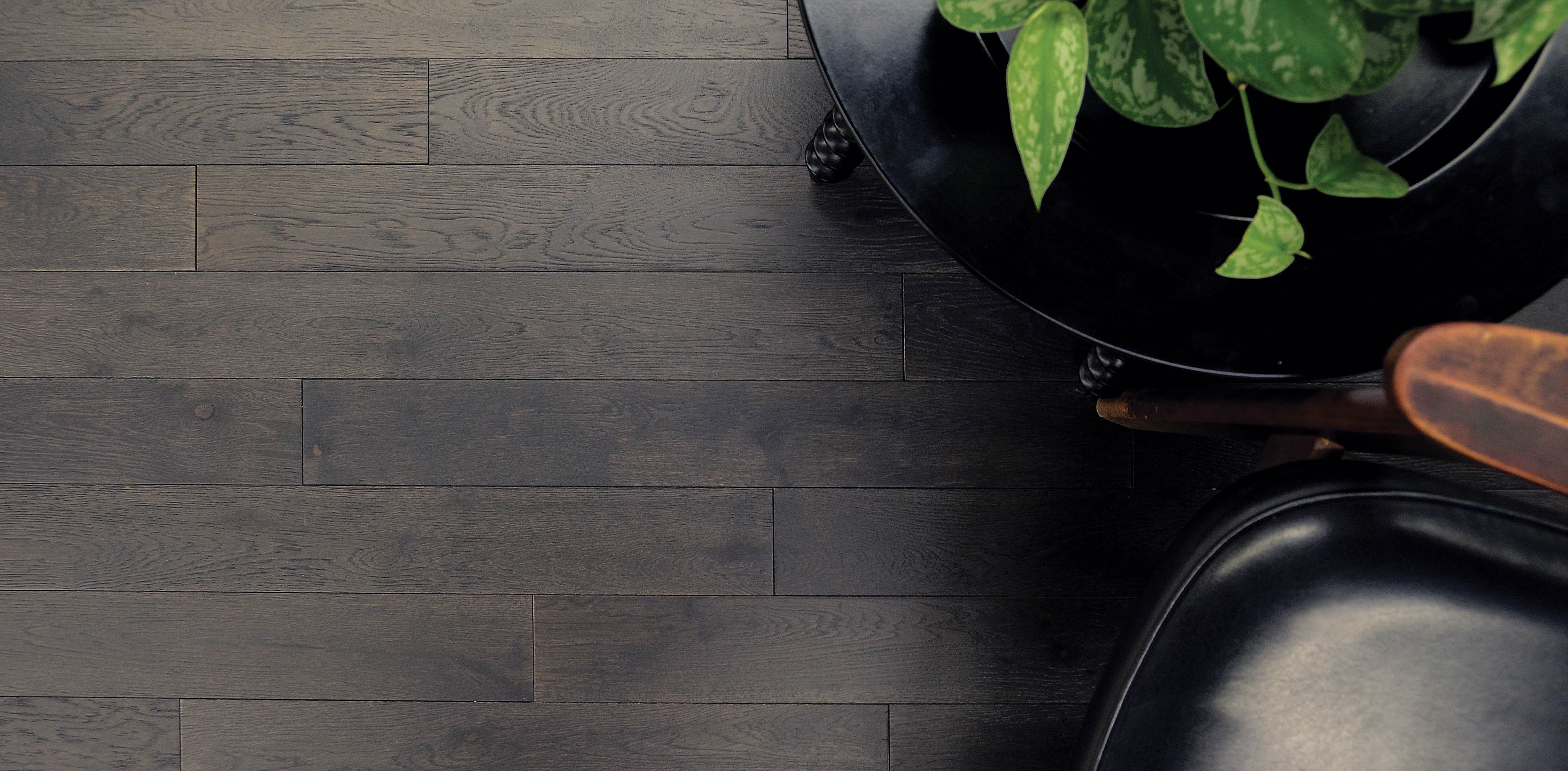 slate-hardwood-flooring-with-chair-and-plant-on-table
